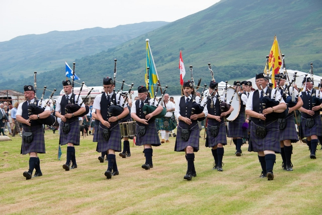 Pipe Band March at Highalnd Games 640x427